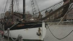 Sailing ship moored up in a dock - stock footage