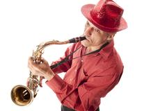 Man with hat playing saxophone Stock Photos