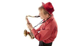 Man playing tenor saxophone from above Stock Photos