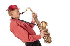 man playing tenor saxophone leaning backwards - stock photo