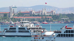 Two ferries sail and University on shore in Istanbul Stock Footage