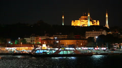 Mosque on coast near river with sailing ferry at night Stock Footage