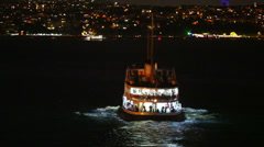 Back of ship sailing at night in Istanbul, Turkey Stock Footage