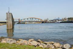 old ijssel railway bridge and adjacent road bridge combined - stock photo