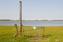 gate with scale of waterlevel in floodplain of the ijssel, the netherlands - stock photo