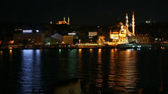 Mosque and Galata Bridge at night in Istanbul, Turkey Stock Footage