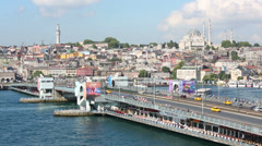 Cars driving over Galata Bridge  and restaurants under bridge Stock Footage