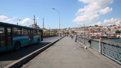 People and cars on Galata Bridge at sunny day Stock Footage