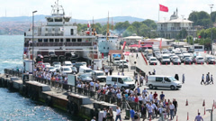 People, cars leave ferry in Istanbul, Turkey Stock Footage