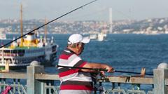 Fisherman on Galata Bridge  in Istanbul, Turkey Stock Footage