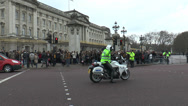 Stock Video Footage of London, Buckingham Palace - police stopping traffic