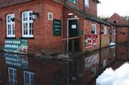 Stock Photo of English pub flooded