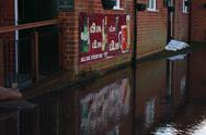 Stock Photo of Pub sign reflected in UK flood water