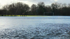 English floods 2014, football pitch under water (zoom) Stock Footage