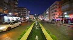 Small fountains and cars on Mehmet Cakir street at night Stock Footage