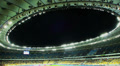 Stadium arena roof evening match football, dark blue sky, lights HD Footage