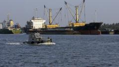 Small Boat Passing by Container Ships in Bangkok Port Stock Footage