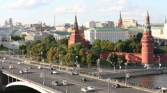 Cars on Big Stone Bridge, Towers of Kremlin in Moscow, Russia Stock Footage
