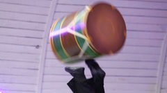 Moving legs of acrobat and cylinder at festival - stock footage