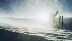 Man Reaching Success Pose Mountain Snow Storm Sun Flare Stock Footage
