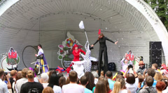 Stock Video Footage of Actors dance on stage at festival of street theater and carnival