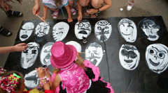 Children paint faces at Japan Day Festival at design factory Stock Footage