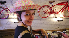 Happy beautiful woman in panama and bikes with baskets Stock Footage