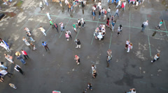 Top view of people walking and throwing disc at asphalt ground Stock Footage