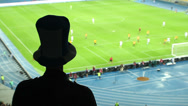 Stock Video Footage of Dangerous football attack, fan high cylinder hat shouting team