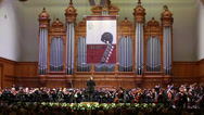 Stock Video Footage of Orchestra play at Gala evening dedicated to 100th anniversary