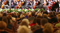 Auditorium listening orchestral music at conservatory hall - stock footage