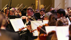 Violinists playing classical music with orchestra - stock footage