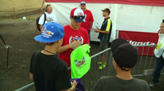 American motocross racer Ryan Dungey gives autographs to fans - stock footage