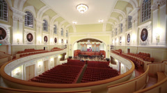 Wide view beautiful hall with empty seats and stage - stock footage