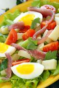 salad with eggs, cherry tomatoes and anchovies. - stock photo