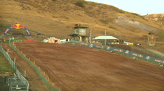 Pan shows workers hosing out motocross track for dirt (AMA1-16) Stock Footage