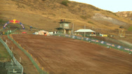 Stock Video Footage of Pan shows workers hosing out motocross track for dirt (AMA1-16)