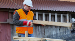 Carpenter with a wooden board episode 2 Stock Footage