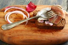 Fork with anchovies closeup. Stock Photos
