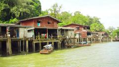 Ranong, thailand - 11 nov 2013: cabins houses  on piles and traditional woode Stock Footage