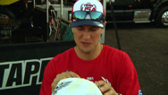 Stock Video Footage of American motocross racer Ryan Dungey autographs fans' objects (AMA1-11)
