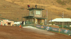 Worker hoses out motocross track for dirt and clay (AMA1-17) Stock Footage