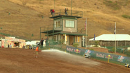 Stock Video Footage of Worker hoses out motocross track for dirt and clay (AMA1-17)