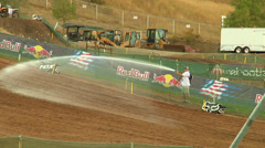 Worker hoses out motocross track for dirt (AMA1-15) Stock Footage