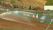 Stock Video Footage of Worker hoses out motocross track for dirt (AMA1-15)