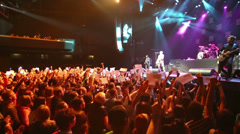 Spectators hold American flags at the concert of DAUGHTRY group Stock Footage