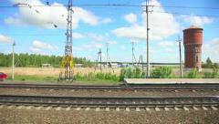 View to pastoral landscape in Russia out of the window of moving train Stock Footage