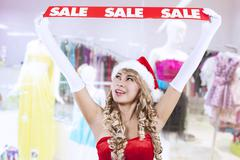 Christmas sale banner by mrs claus at mall Stock Photos