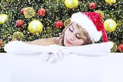 Mrs claus with copyspace over christmas tree Stock Photos
