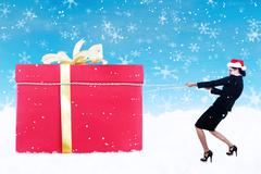 Business woman pull christmas gift in snow with chain Stock Illustration